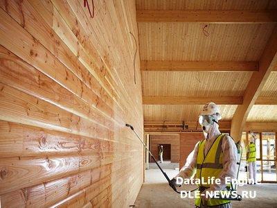 Важность обработки дерева антипиреном при строительстве деревянного дома