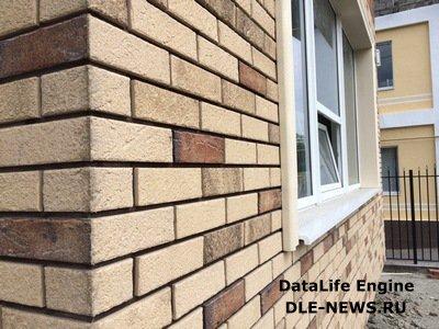 Покрытие фасада каменной плиткой